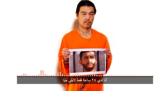 Islamic State hostages: Japanese journalist Kenji Goto holds what appears to be a photo of Jordanian pilot 1st Lieutant ...