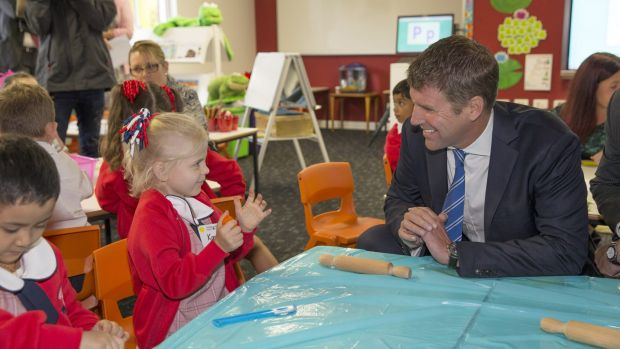 First termers: Premier Mike Baird meets kindergarten student Kassie at the opening day of the Ponds High and Riverbank ...
