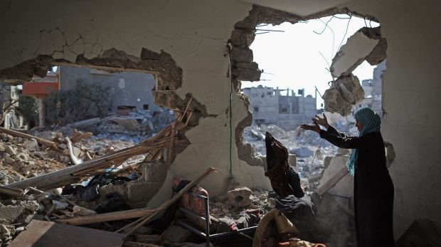 Islam al-Masri sorts through the rubble of her destroyed home in the Gaza Strip town of Beit Hanoun in August of last year.