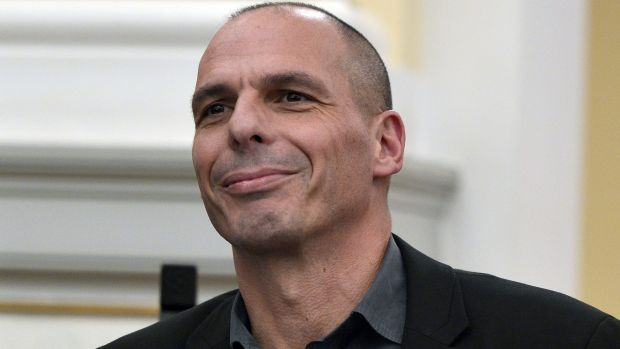 Greek Finance Minister Yanis Varoufakis smiles during the civil oath ceremony at the Presidential Palace in Athens on ...