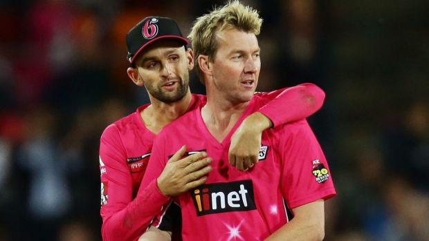 Fine career: Brett Lee, right, celebrates with Nathan Lyon after he claims a wicket.