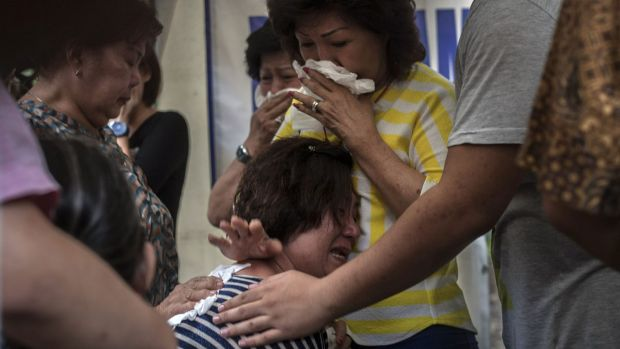 Relatives of missing AirAsia passengers grieve in Indonesia.