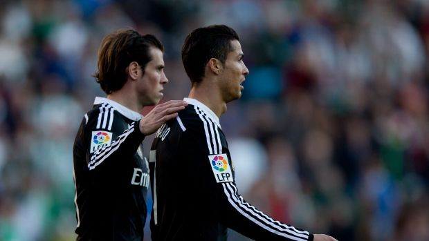 Ronaldo, right, is consoled by teammate Bale.