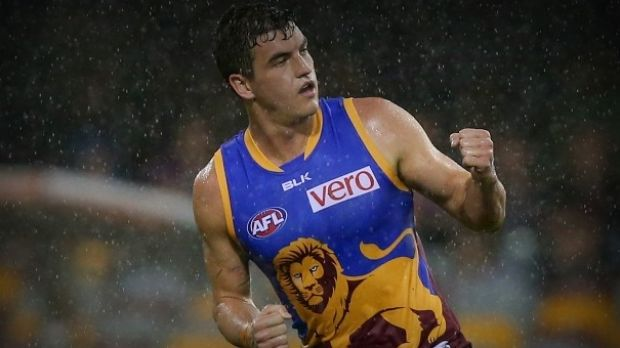 On the move: Tom Rockliff.
