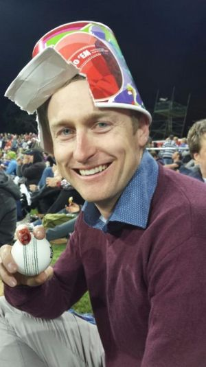 Tom Zouch with the ball he caught at the BBL half time show which broke his finger.