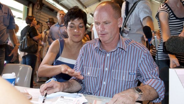 Campbell and Lisa Newman at a polling booth for the 2012 election.