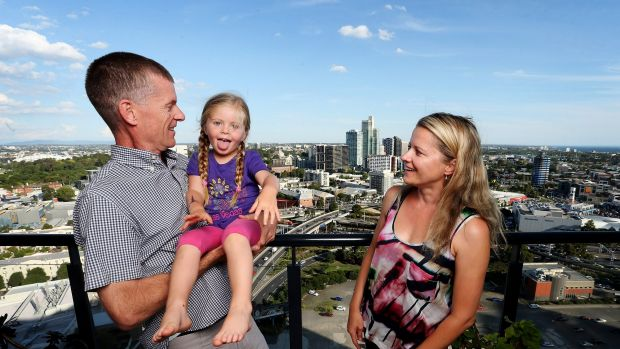 Marton Sadler with his wife Agata and child Olivia in their Southbank high-rise apartment.