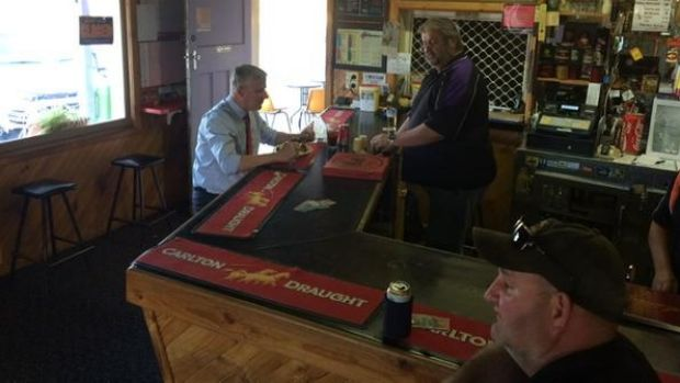 Michael McCormack has a bite to eat at the Royal Hotel in Grong Grong on Thursday.