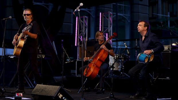 Steve Kilby from The Church performs in Martin Place for the Music for Mercy concert.