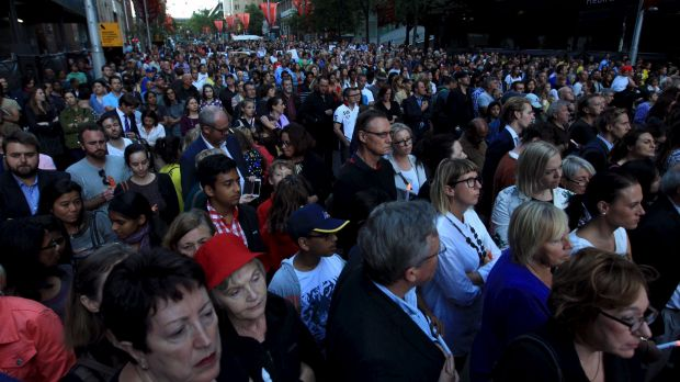 A large crowd gathers for the vigil.