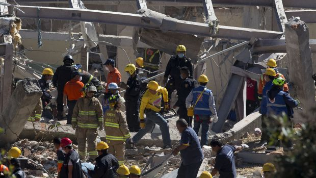 Rescue workers comb through the rubble of the children's hospital, which collapsed after the tanker explosion.