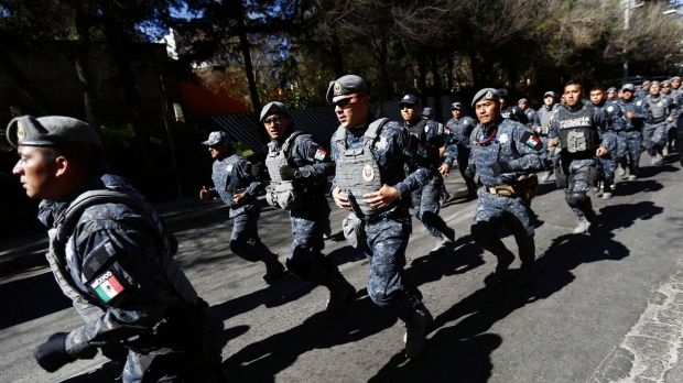 Police officers are deployed near the site of an explosion at a maternity hospital in Mexico City.