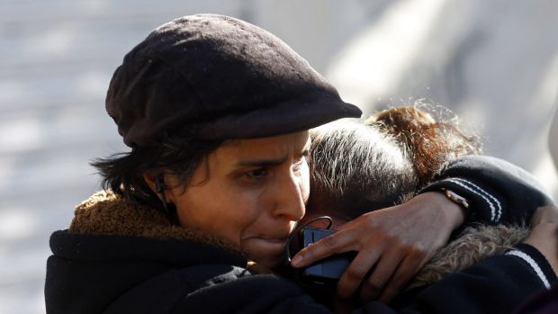 Relatives of victims cry at the site of an explosion at a maternity hospital in Mexico City.