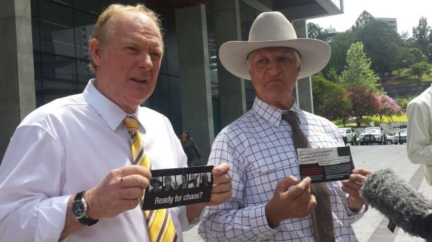 KAP state leader Shane Paulger and leader Bob Katter display LNP pamphlets outside Brisbane's Supreme Court.