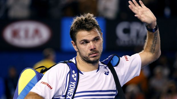 Sad farewell: Defending champion Stan Wawrinka leaves Rod Laver Arena after losing in five sets.