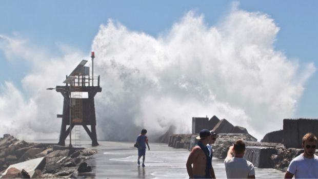 A monster wave that washed a woman off Nobbys breakwall in Newcastle.