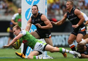 Lachlan Croker of the Raiders scores a try against the Tigers.