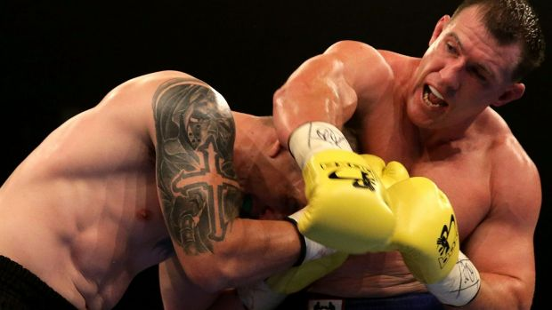 Paul Gallen throws a right at Randall Rayment.