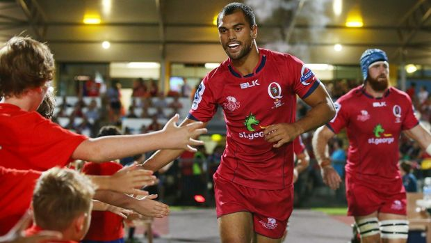 Karmichael Hunt of the Reds runs out in his return to rugby.