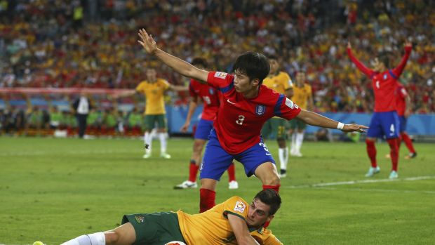 Fouled but not out: Tomi Juric of Australia competes for the ball before setting up the winning goal by James Troisi.