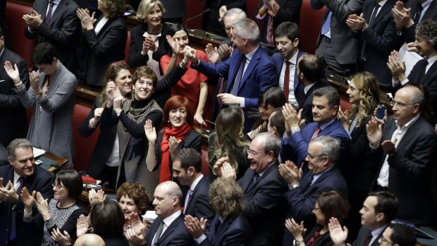Italian legislators applaud the election of Italy's new President Sergio Mattarella.