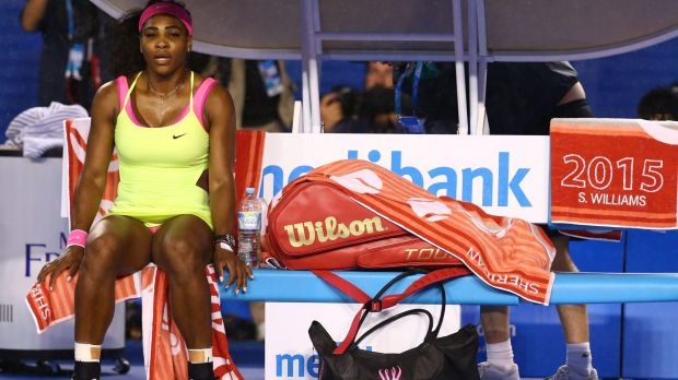 Serena Williams waits for the roof to be closed after it began to rain.