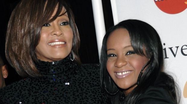 Singer Whitney Houston, left, with her daughter Bobbi Kristina Brown in 2011.