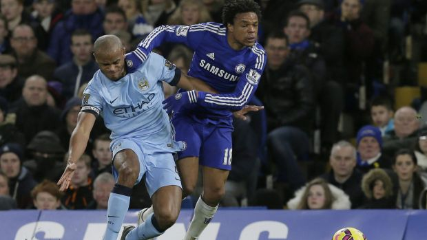 Battling: Chelsea's Loic Remy competes for the ball with Manchester City's Vincent Kompany during the English Premier ...