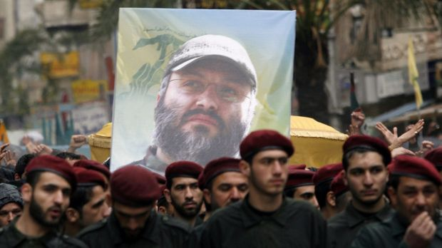 Hezbollah militants carry the coffin of slain commander Imad Mughniyah through the streets of Beirut in 2008.