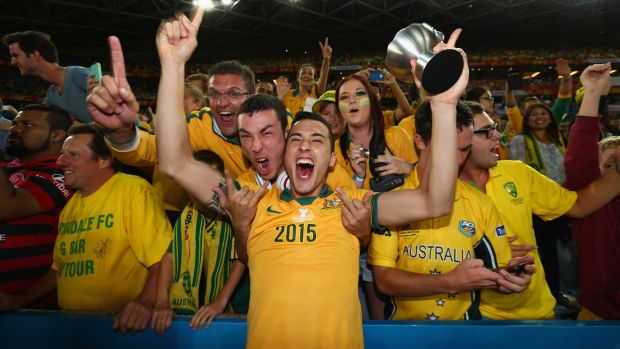 Jason Davidson of Australia celebrates with fans after Australia defeated South Korea in the 2015 Asian Cup final.