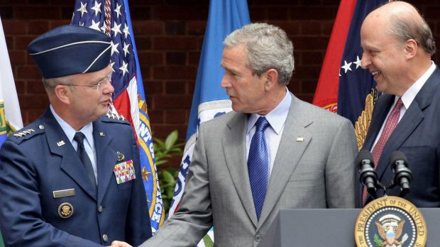 US president George W. Bush shakes hands with Air Force General Michael Hayden, director of the CIA at the time of the ...