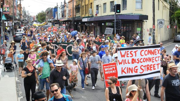 Concerned residents take to the streets of Newtown, Sydney, to protest the proposed development of the NSW government's ...