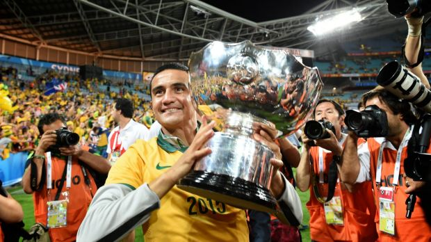 Look out world: Tim Cahill enjoys the plaudits after winning the Asian Cup with the Socceroos.