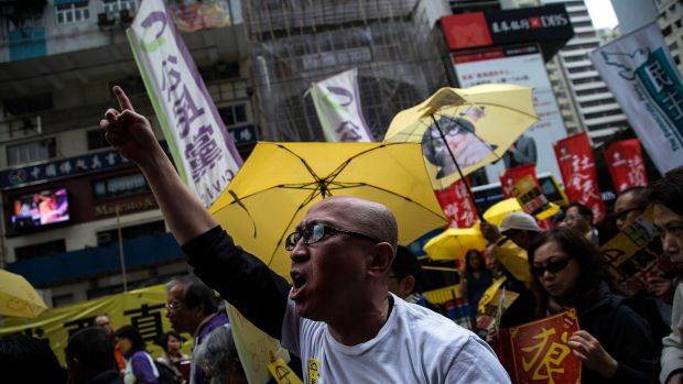 Protesters march through the centre of Hong Kong on Sunday.