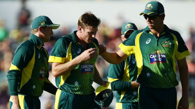 PERTH, AUSTRALIA - FEBRUARY 01:  James Faulkner of Australia is consoled by teamates as he leaves the field injured ...
