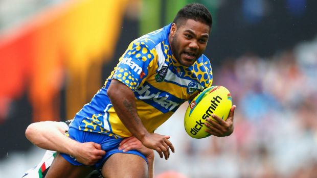 Injury scare: Chris Sandow is tackled during the Eels' match against the Rabbitohs in the Auckland Nines.
