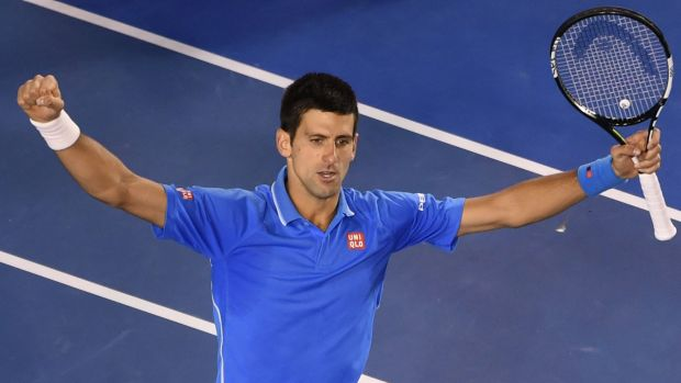 Serbia's Novak Djokovic gestures as he celebrates his victory.
