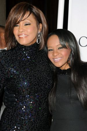 Bobbi Kristina with her mother, Whitney Houston, in 2011.