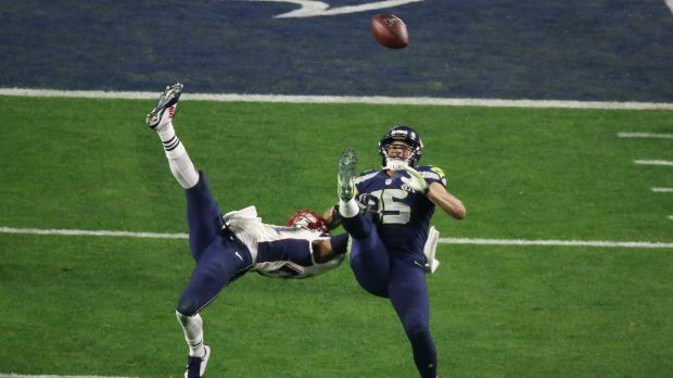 Seattle wide receiver Jermaine Kearse prepares to make a catch against Patriot Malcolm Butler.