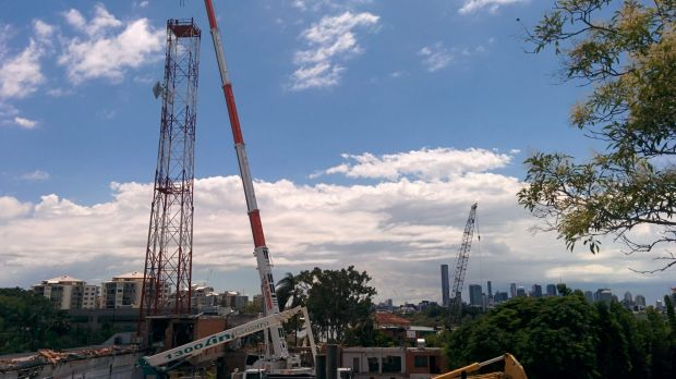 The antenna tower at the old ABC studios in Toowong is demolished on Monday, February 2.
