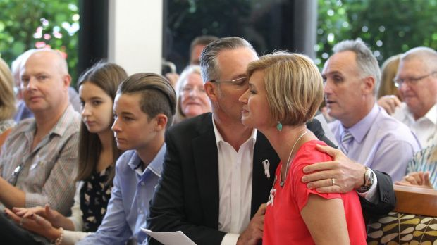 Remembered: Kathryn Szyszka is comforted by her husband Walter Szyska after speaking at the first community memorial ...