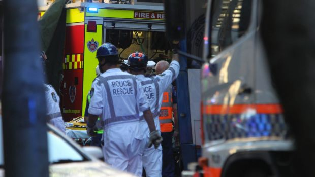 Emergency services work to free Christine Mulholland, who died after being hit by a bus on Clarence Street.