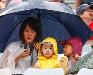 Rain did not dampen the spirit of an enthusiastic crowd during last month's Asian Cup.  Canberra Times photo by Matt Bedford