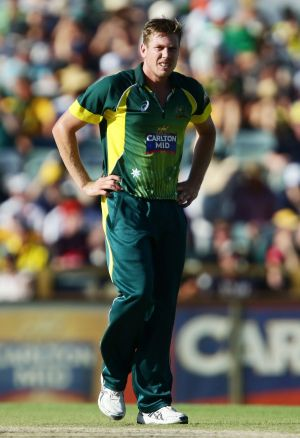 Casualty: James Faulkner shows discomfort before leaving the field injured against England.