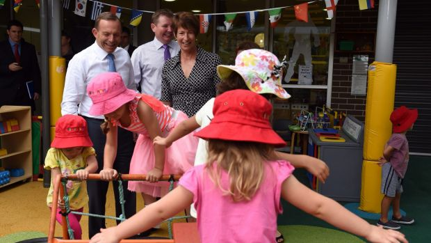 Tony Abbott and his wife Margie meet kids at the Little Pines Childcare Centre in Russell Lea on Tuesday.