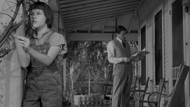 Mary Badham and Gregory Peck as Scout and Atticus Finch in the 1962 movie of <i>To Kill a Mockingbird</i>.