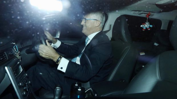 Malcolm Turnbull drives himself to Parliament House in Canberra on Wednesday morning.