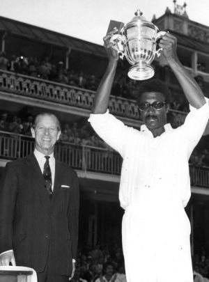 Clive Lloyd is presented the 1975 World Cup by Prince Phillip.