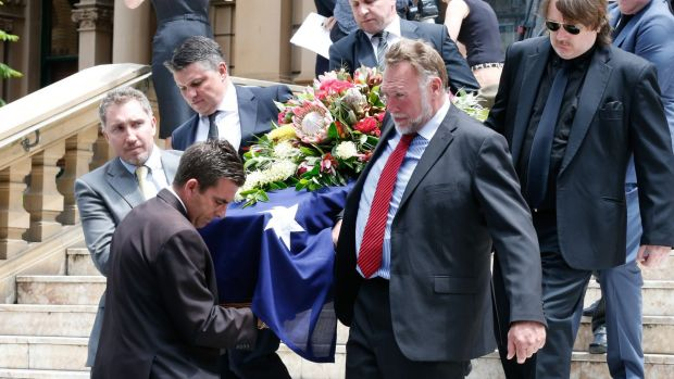 Pallbearers came from the ranks of family members and friends.