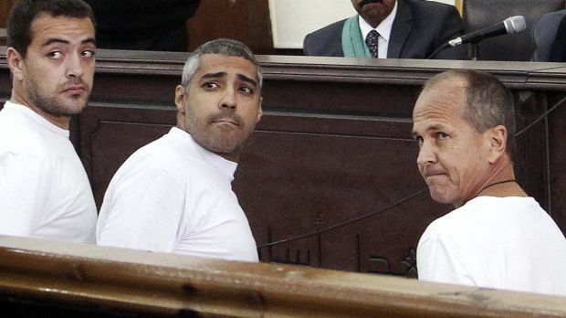 'It is not enough': Peter Greste with his al-Jazeera English colleagues Baher Mohamed, left, and Mohamed Fahmy in court ...